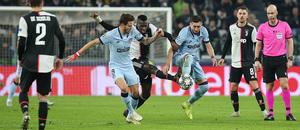 Temp. 19/20. Liga de Campeones. Juventus-Atlético de Madrid. Herrera y Saúl