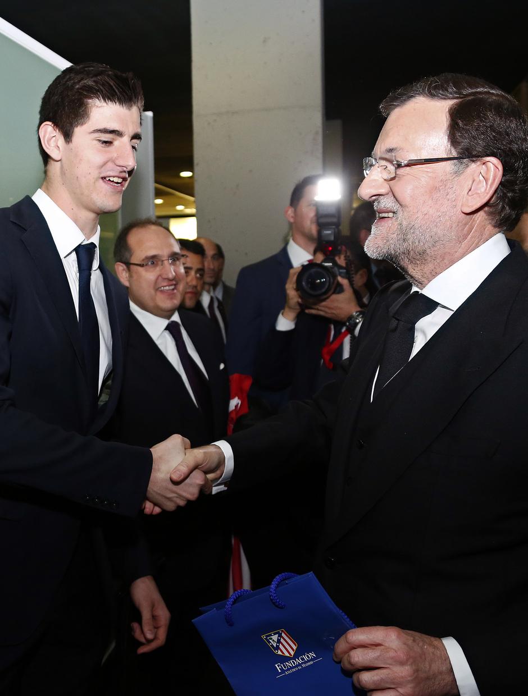 Rajoy saluda a Courtois