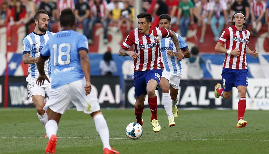 temporada 13/14. Partido Atlético de Madrid_Málaga. Sosa con el balón
