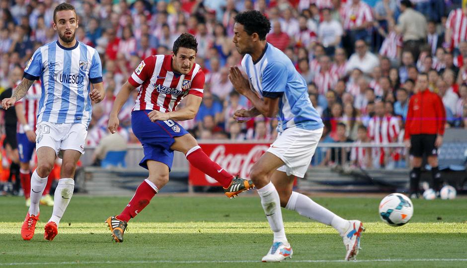temporada 13/14. Partido Atlético de Madrid_Málaga. Koke disparando a puerta. Apo Caballero