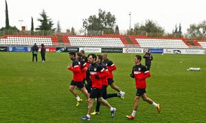 Temporada 12/13. Entrenamiento. Plano general, jugadores corriendo durante el entrenamiento en la ciudad deportiva de Majadahonda