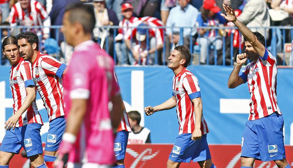 Temporada 12/13. Partido Atlético de Madrid Granada.celebración de Diego Costa con el dedo en la boca