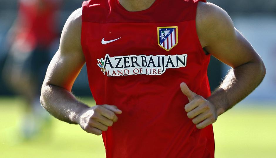 Temporada 2013-2014. Mario Suárez se ejercita en la Ciudad Deportiva de Majadahonda durante la pretemporada