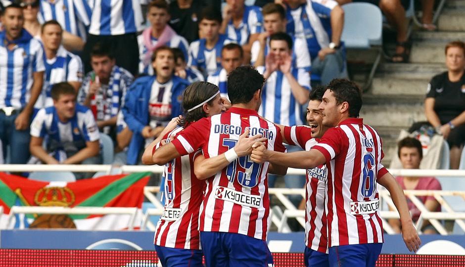 Temporada 2013/2014 Real Sociedad - Atlético de Madrid Los jugadores celebrando el gol de Villa