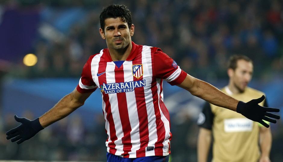 Diego Costa celebra uno de los goles en su debut en Champions con la camiseta rojiblanca