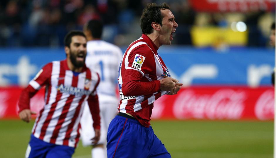 temporada 13/14. Partido Atlético de Madrid- Levante.  Godín celebrando un gol
