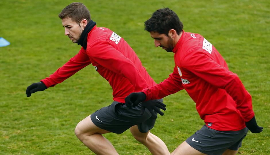 temporada 13/14. Entrenamiento en la Ciudad deportiva de Majadahonda. Gabi y Raúl corriendo durante el entrenamiento