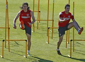 temporada 13/14. Entrenamiento en la Ciudad deportiva de Majadahonda. Filipe y Koke realizando ejercicios físicos