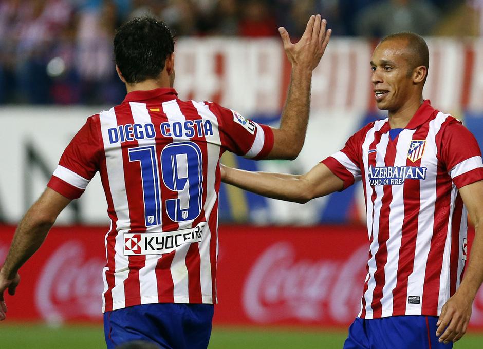 temporada 13/14. Partido Atlético de Madrid- Elche. Diego Costa y Miranda celebrando un gol