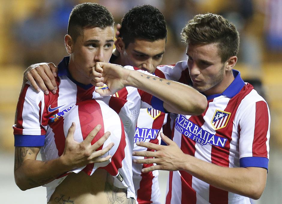 Pretemporada 2014-15. Atlético de Madrid - Sampdoria. Trofeo Ramón de Carranza. Giménez se besa el dedo tras su gol.