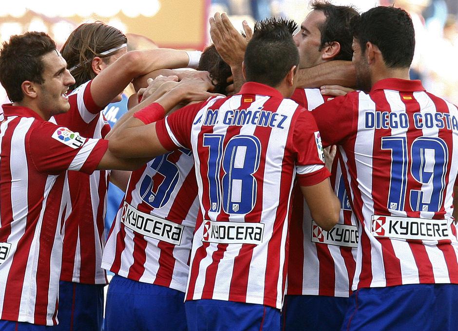 Temporada 13/14. Partido Atlético de Madrid Almería. Celebración gol de Tiago piña del equipo