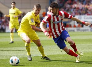 temporada 13/14 Partido. Atlético de Madrid_Villarreal. Villa con el balón. Alexander Marín